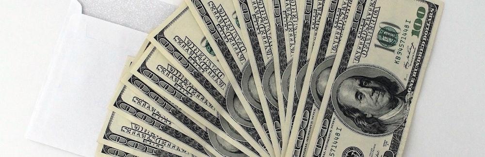 A stack of hundred dollar bills.